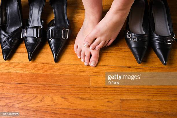 dress shoes and high heels with woman's feet on floor - fetish wear stock photos and pictures