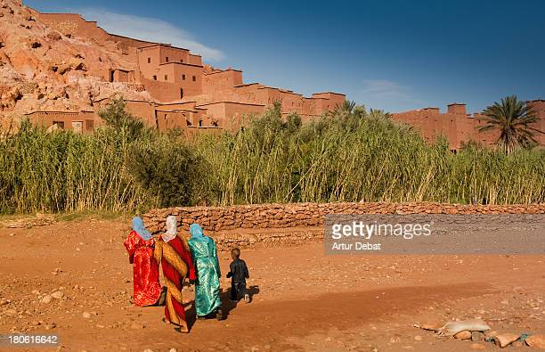 CONTENT] dress tradition african africa morocco Unesco Ait Ben Haddou travel trip tour dry desert constrcution architecture fortress mud sky blue