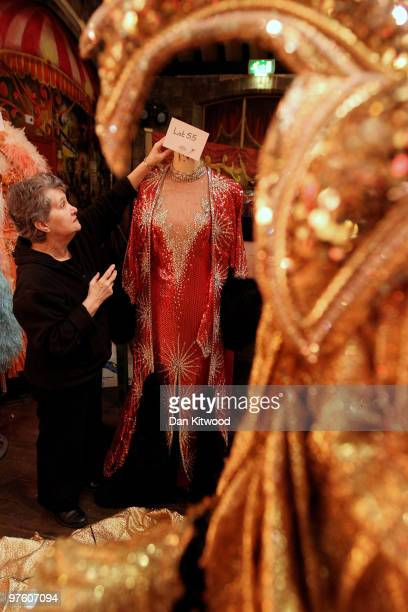 A dress which was previously worn by female impersonator Danny La Rue is checked by Danny La Rue's former costumier and personal assistant Anne...