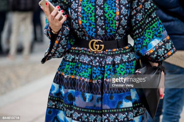 A dress with a Gucci belt outside during Milan Fashion Week Fall/Winter 2017/18 on February 23 2017 in Milan Italy