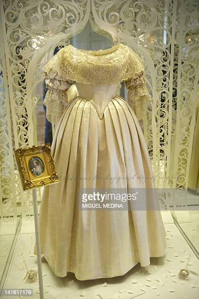 A dress worn by Britain's Queen Victoria on her wedding day to Prince Albert in 1840 is pictured in Kensington Palace in central London on March 20...