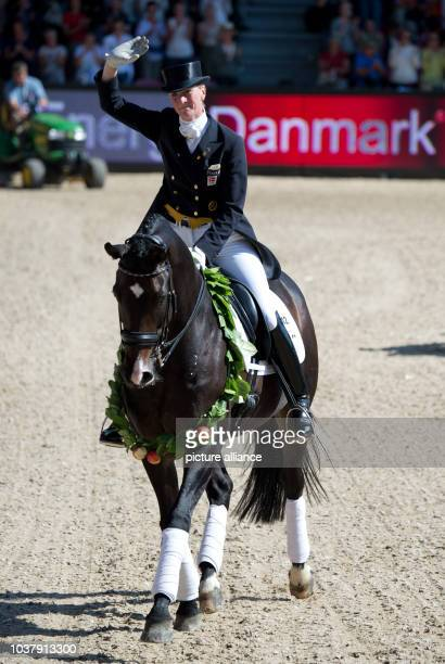 Dressage rider Nathalie zu Sayn Wittgenstein from Denmark performs her skills with horse Digby during the Grand Prix competition of the FEI European...