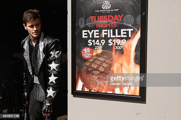 Dressed as a member of Kiss, Trent Cotchin emerges from the Sporting Globe Hotel to speak to the media at the Richmond Tigers AFL Mad Monday...