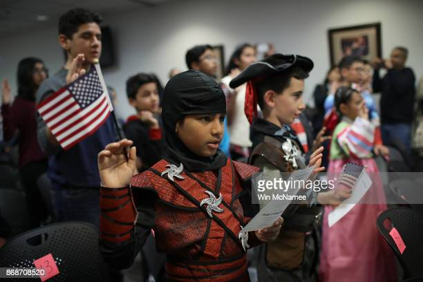 Dressed as a ninja Shaheer Sarwar from Pakistan takes the oath of US citizenship with other children during a Halloweenthemed citizenship ceremony...