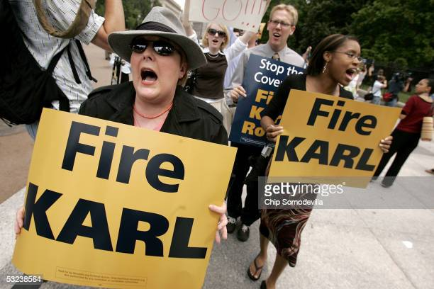 Dressed as a spy, Christine Baker , of Mannassas, Virginia, joined about 200 others for a rally and march in front of the White House July 14, 2004...