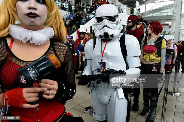 Dressed as a Stormtrooper Eugene Lopez waits in the weapons prop check line during Denver Comic Con at the Colorado Convention Center in Denver CO...