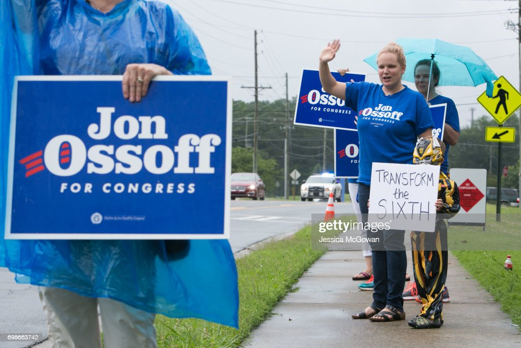 Dressed as a Transformer character, Malcolm Nichols, 5, stands with Melissa Cochran campaigning for Democratic candidate Jon Ossoff outside of the East Cobb Government Center on June 20, 2017 in Marietta, Georgia. Handel and Ossoff are running against each other in a special election to fill the congressional seat vacated by Secretary of Health and Human Services Tom Price.