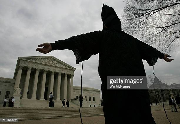 Dressed as in infamous Abu Ghraib prison garb Jose J Rodriguez protests the appointment of Alberto Gonzalez as the new US Attorney General February 9...