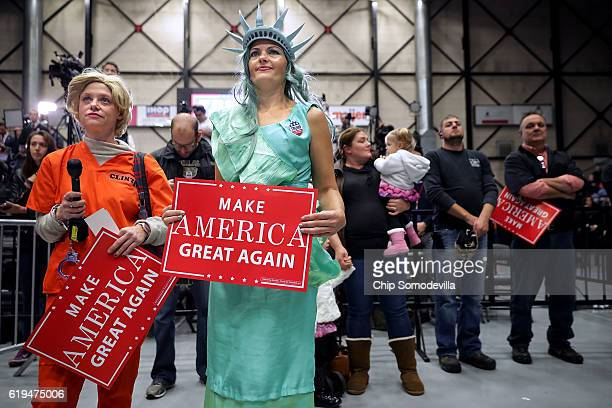 Dressed as Lady Liberty Mary Simcox of Portland Michigan and Laurie Sanger of Grand Rapids costumed as Democratic presidential nominee Hillary...