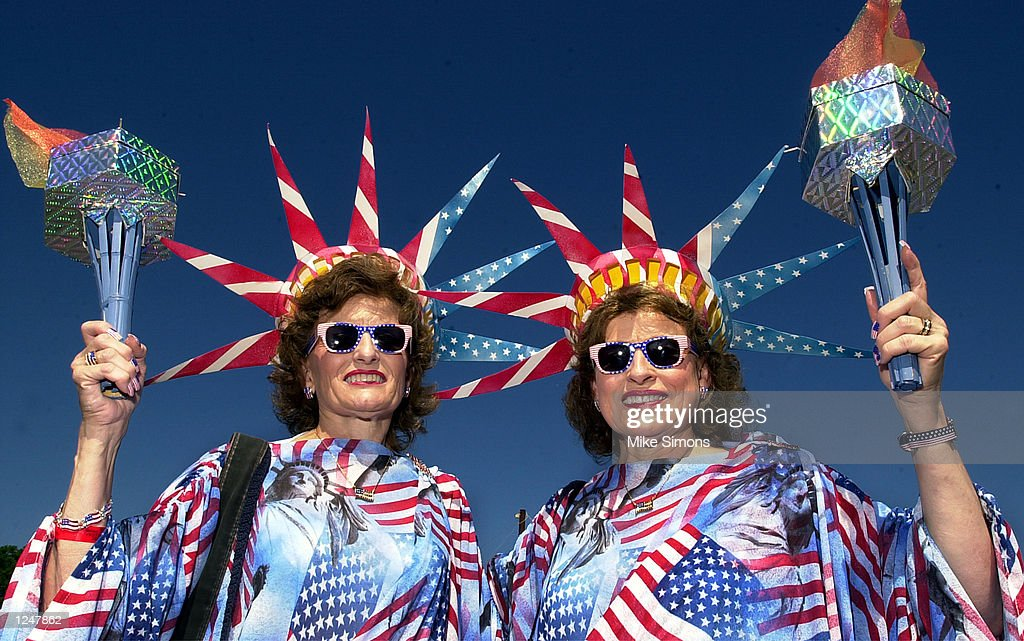 Dressed as the Statue of Liberty Jeanette Meadows and her twin sister Geneva Petitt pose for a photo August 3, 2002 at the Twins Days Festival in Twinsburg, Ohio.