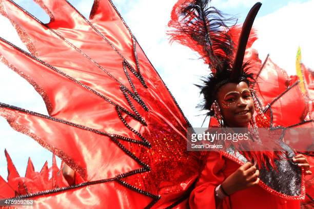 A dressed child pose for a photo during the Republic Bank Children's Carnival Parade on March 01 2014 in Port of Spain Trinidad