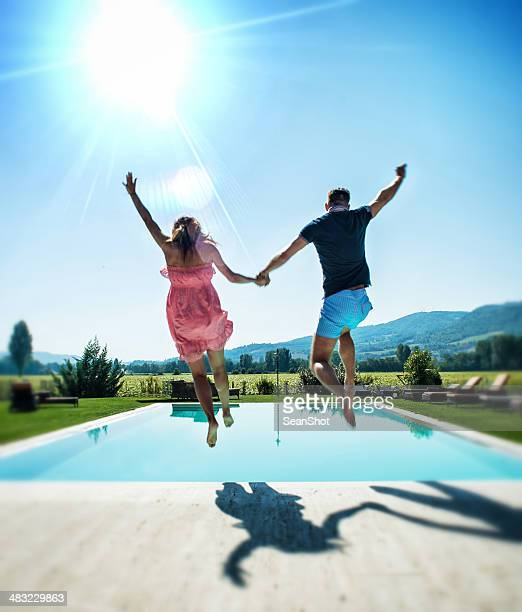 Dressed Couple Diving in Swimmingpool