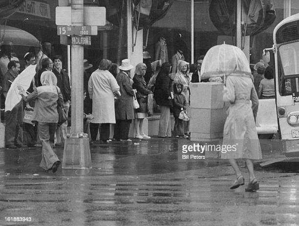 MAY 20 1977 MAY 21 1977 Dressed for Dryness Umbrellas and raincoats were the order of the day for people on their way home from downtown Denver...