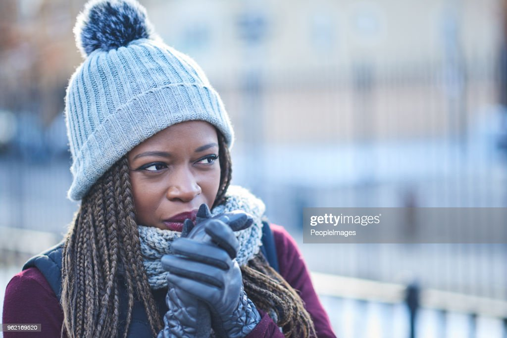 Dressed for warmth when the temperature drops : Stock Photo