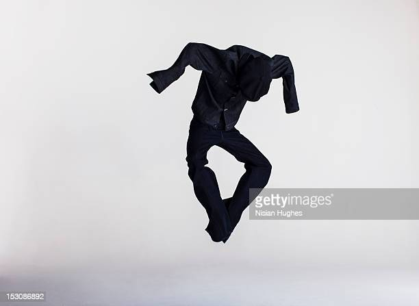 dressed human shape jumping in air