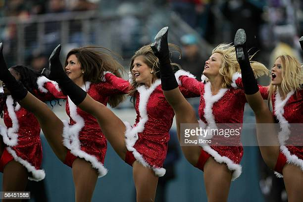 Dressed in a Christmas theme Jaguars cheerleaders perform during a stoppage in play as the Jacksonville Jaguars take on the San Francisco 49ers at...
