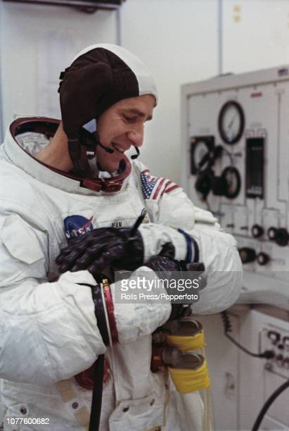 Dressed in a full space suit United States astronaut Alan Bean Lunar Module pilot on the Apollo 12 mission to the Moon prepares for a training...