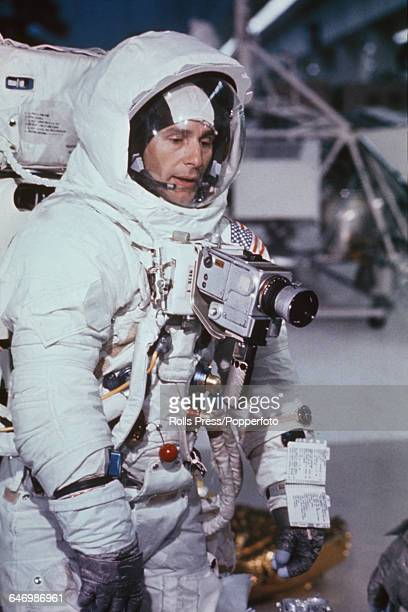 Dressed in a full space suit United States astronaut Alan Bean lunar module pilot on Apollo 12 mission undertakes a training simulation exercise at...