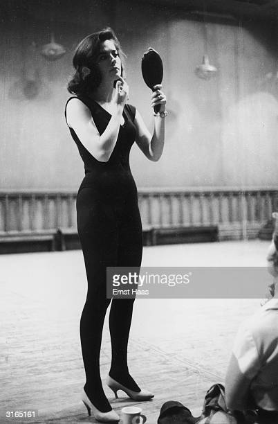 Dressed in a leotard tights and high heels American actress Natalie Wood checks her makeup during dance rehearsals for Jerome Robbins' and Robert...