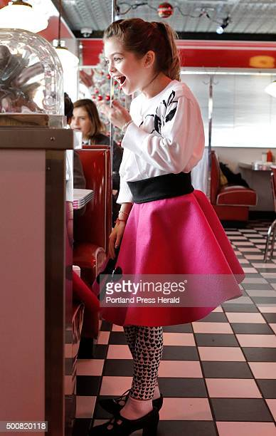 Dressed in a poodle skirt Addison Macavian laughs while talking with a classmate at the Blast From the Past diner in Waterboro on Wednesday December...