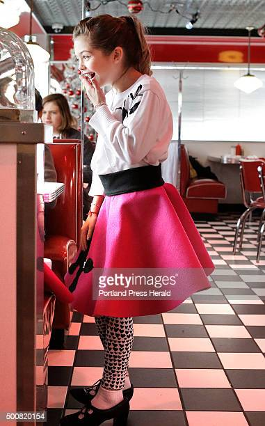 Dressed in a poodle skirt Addison Macavian laughs while talking with a friend at the Blast From the Past diner in Waterboro on Wednesday December 9...