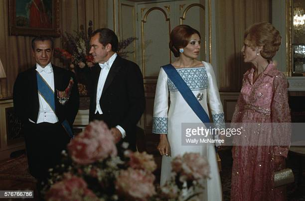 Dressed in formal wear for a state dinner at the Shah's palace in Tehran are US President Richard Nixon First Lady Pat Nixon Reza Pahlevi Shah of...