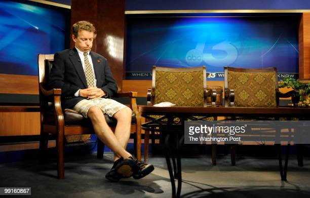 Dressed in half a suite after running from his son's soccer game Dr Rand Paul waits to be a guest on a Fox News program May 5 in Bowling Green...