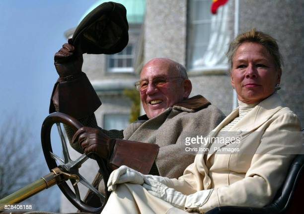 Dressed in period costume Sir Stirling and Lady Susie Moss at the wheel of a 1907 Renault at Goodwood House near Chichester West Sussex Thursday...