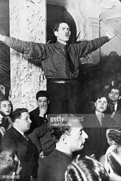 Dressed in the blue shirt associated with the National Syndicalists, their leader Rolao Preto, whose appearance is not unlike that of Hitler,...