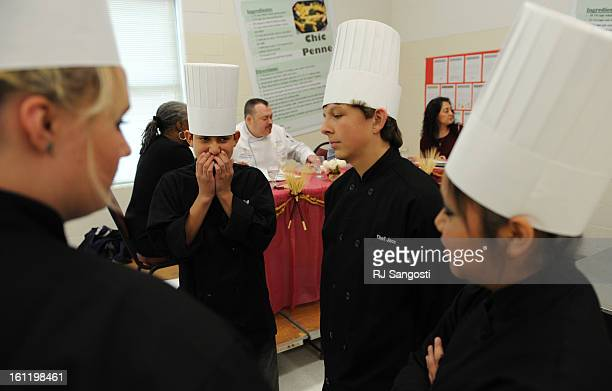 Dressed in their chef hats 8th graders at Winograd School in Greeley from left Bethany Vierow Abe Aguioar Jace Keopke and Amairani Pizarro are...