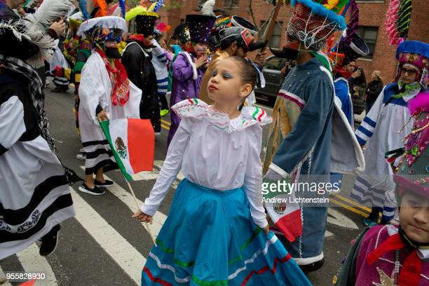 Dressed in traditional folk costumes New York City's Mexican community prepares to celebrate Cinco de Mayo by marching in an annual parade on May 6...
