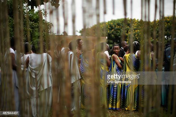 Dressed in traditional gowns women line up before marching to commemorate the genocide of 1994 at the Kicukiro College of Technology football pitch...