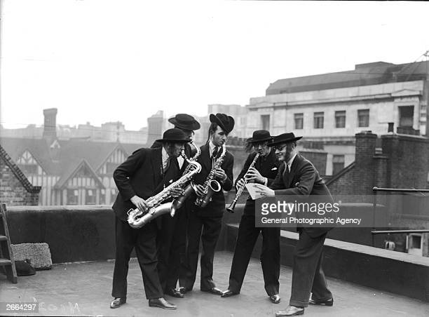 Dressed in traditional Jewish garb Mackay's Dance Band perform on the roof of the Palladium London