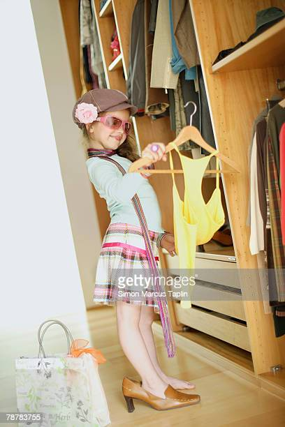 dressed up girl at wardrobe - adult imitation stock pictures, royalty-free photos & images