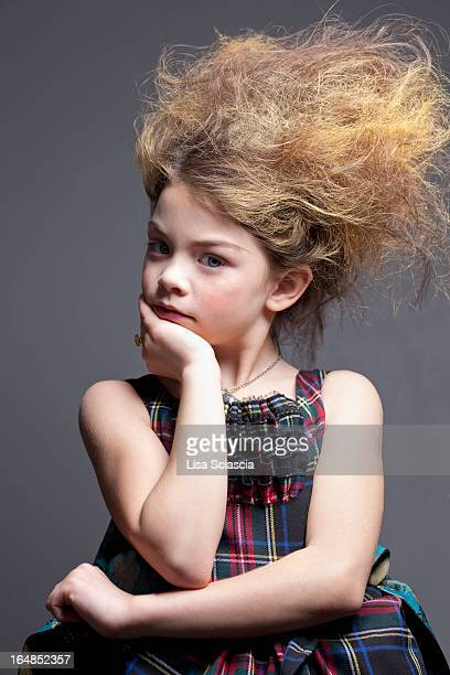 Dressed up girl in tartan dress with hair back