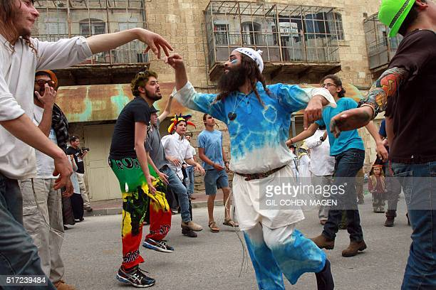Dressed up Israeli settlers take part in a parade during the festivities of the Jewish holiday of Purim on March 24 2016 in the West Bank town of...