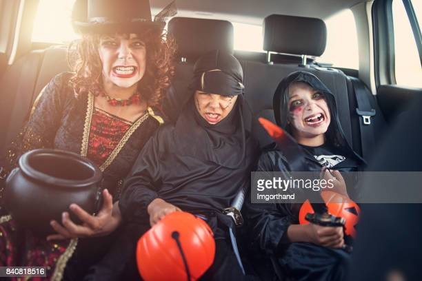Dressed up kids on their way to halloween party