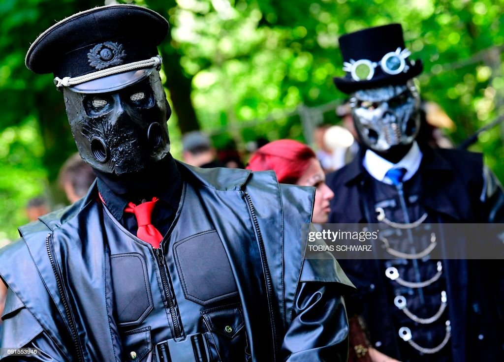 Dressed up people attend a so-called 'Victorian Picnic' during the Wave-Gotik-Treffen (WGT) festival in Leipzig, eastern Germany, on June 2, 2017. /