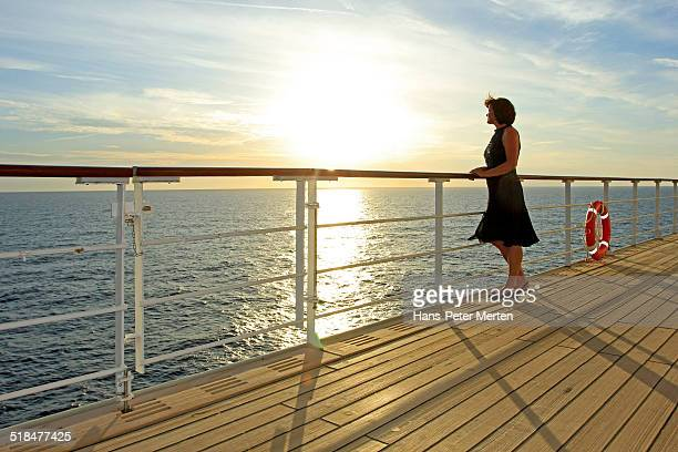 dressed up woman on deck of a cruise ship - ponte di una nave foto e immagini stock