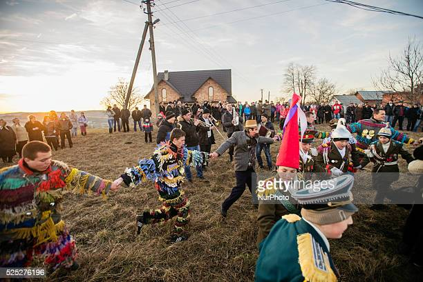 Dressed villagers dancing in a ring during Malanka celebration in Velykyj Kuchuriv village Bukovina Ukraine