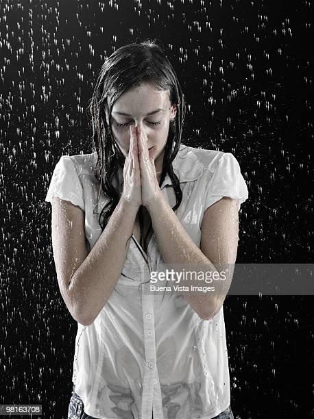 Dressed woman under shower