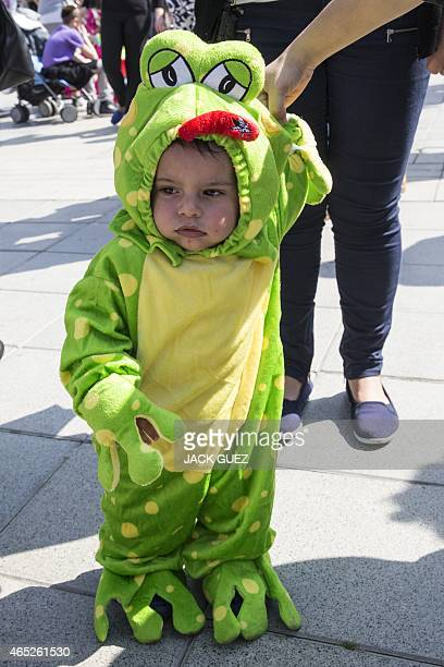 A dressedup Israeli baby takes part in a parade during the festivities of the Jewish Purim festival on March 5 2015 in the central Israeli city of...