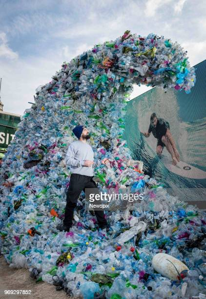 MELBOURNE VIC Dresser Bryan Scanlon puts the finishing touches on the Corona 'Wave of Waste' sculpture made of 1580 metric tonnes of waste at...