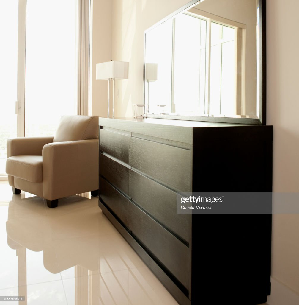 Dresser Mirror And Armchair In Modern Bedroom High Res Stock Photo Getty Images
