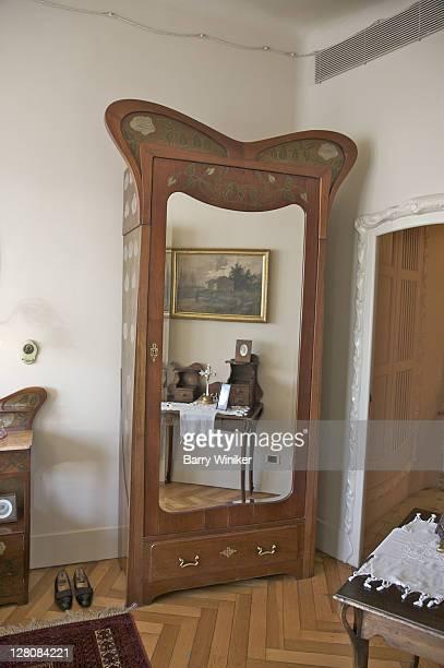 dresser with mirror in bedroom of apartment at casa mila, barcelona, catalonia, spain - casa stock-fotos und bilder