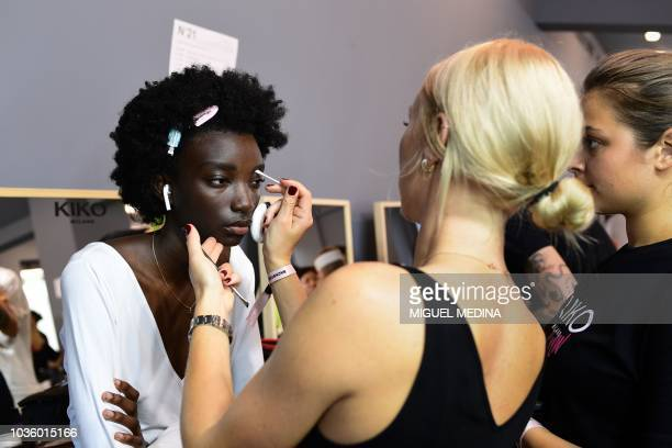 Dressers and models wait backstage prior the N21 fashion house Women's Spring/Summer 2019 fashion show in Milan on September 19 2018