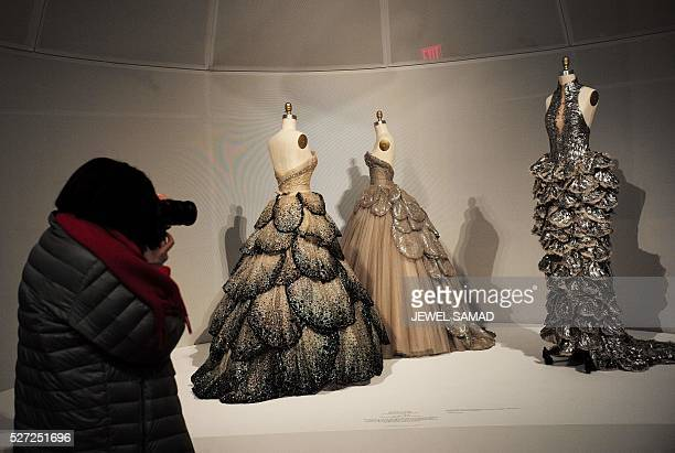 Dresses are displayed during the press preview of the Metropolitan Museum of Arts Costume Institute spring 2016 exhibition Manus x Machina Fashion in...