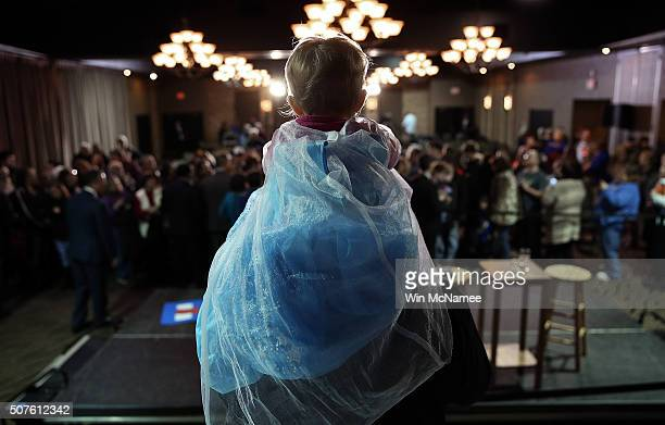 Dresses as a princess Evelyn Schroedermier sits on her father Clark's shoulders while waiting to greet Democratic presidential candidate former...