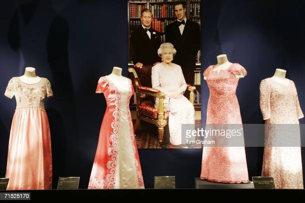 Dresses by Sir Norman Hartnell, John Anderson and Stewart Parvin designed for Queen Elizabeth II at an exhibition her dresses in the State Rooms of...