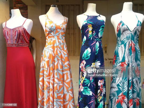 dresses display on mannequins at store - womenswear stock pictures, royalty-free photos & images